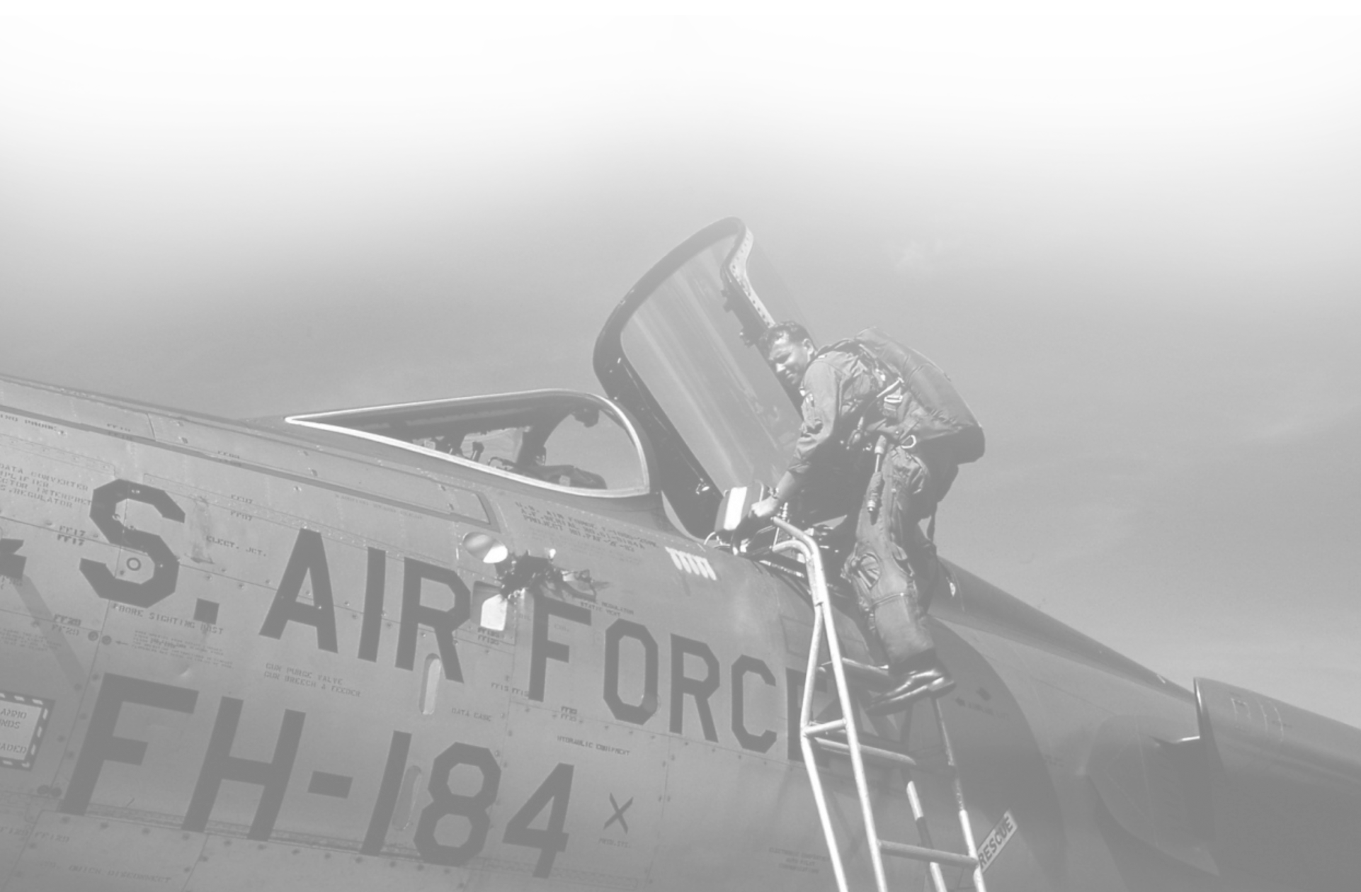 archival photo airman climbing in to cockpit