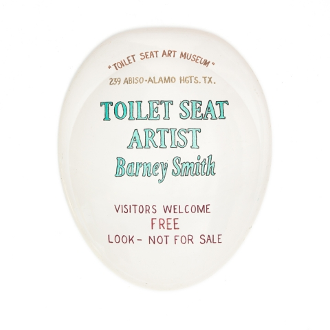 Barney Smith's Toilet Seat Art Museum - Seat with museum sign